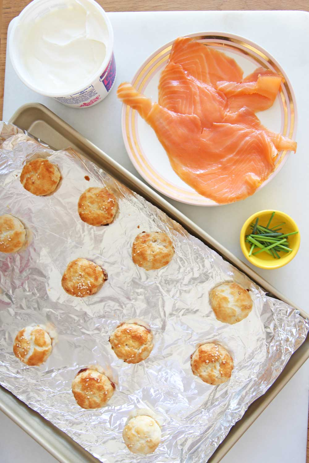 Lox and Potato Knish Recipe. This is potato knish, lox, sour cream, and chives. This is the perfect New Years appetizer, Holiday appetizer, or game night eats. This is super easy. Happy Cooking! www.ChopHappy.com