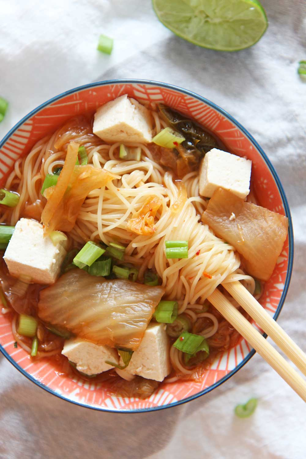 How to Make Kimchi Ramen Soup in a Slow Cooker. Grab noodles, tofu, kimchi, and scallions. Perfect soup that is all done in the crock pot. Happy Cooking! www.ChopHappy.com #souprecipe #ramenrecipe