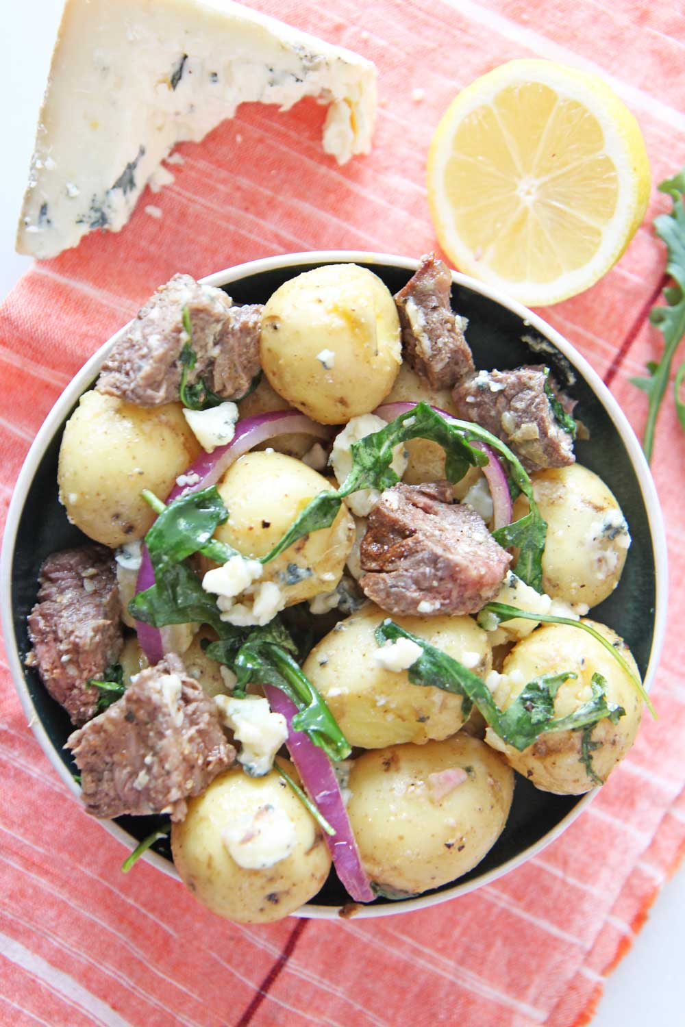 Steakhouse Steak and Potato Salad. This is a 20 minute recipe for busy weeknightt dinner. NY strip steak and Yukon gold potatoes mix with blue cheese and peppery arugula! Perfect next day leftovers. #potatosalad #perfectsteak