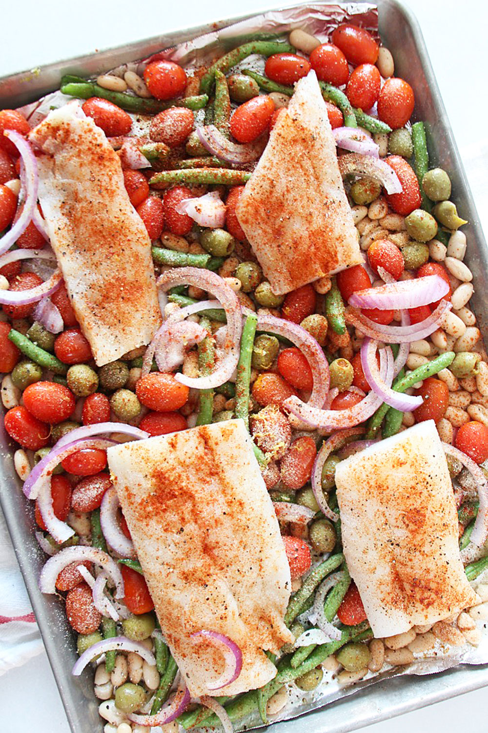Sheet Pan Cod and Veggie Recipe. This is a quick weeknight dinner with very little clean up. Cod is the perfect fish recipe for an easy mild fish flavor. Happy Cooking! www.C hopHappy.com #codrecipes #fishrecipes