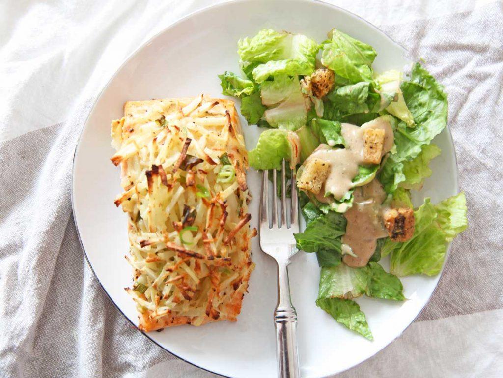 Latke Crusted Salmon on a sheet pan. This is a perfect Jewish Holiday Recipe. Make this as a Rosh Hashanah recipe, Hanukkah recipe, Yom Kippur recipe, or Shabbat recipe. Happy Holidays. www.ChopHappy.com #jewishrecipes #jewishholidayrecipes