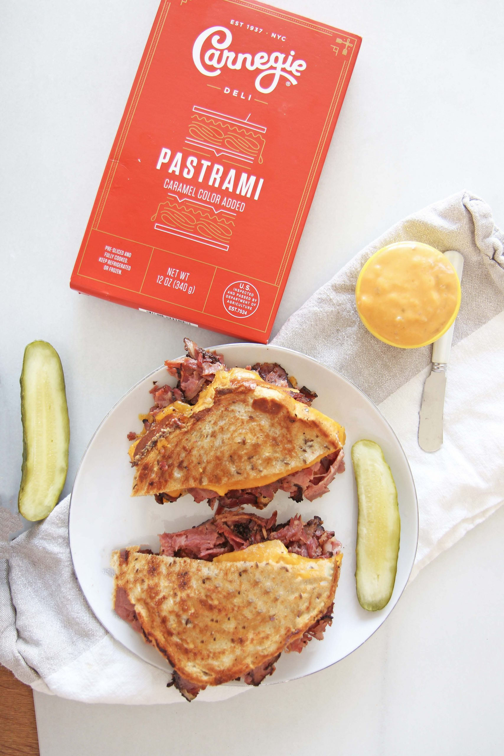 Jewish Grilled Cheese Recipe. This is classic NYC eats. The iconic Carnegie Deli has the best pastrami. I used their pastrami, half sour pickles, and Russian dressing to make the ultimate grilled cheese. Happy Cooking! #NYCeats #grilledcheese